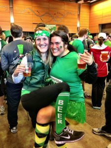 Two runners enjoy a beer