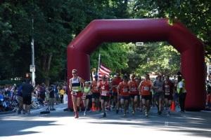 Runners get a fast start down 4th Street toward downtown